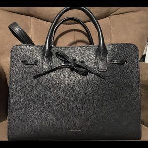 Black handbag.